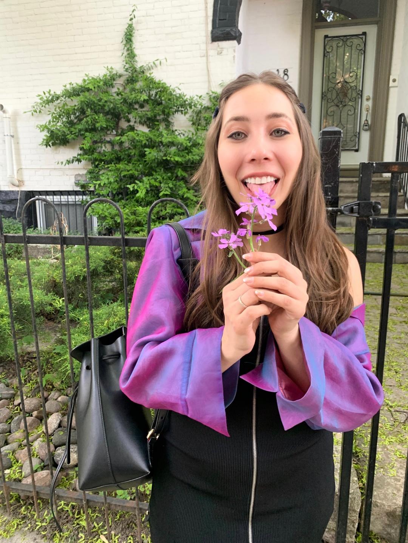 girl liking flower